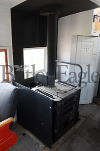 Harold Aughton/Butler Eagle: This oil stove sits inside the Cooper Station caboose. John Lasher, co-owner of Cellar Works Brewing and his partner ,? recently, sold the Coopers Station caboose to Butler-Freeport Community Trails.