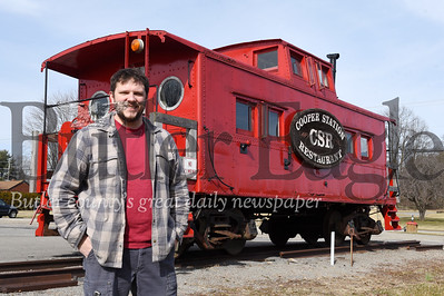 John Lasher, co-owner Cellar Works Brewing stands in front of the Cooper Station caboose. Lasher and his partner ,? recently, sold to the caboose to Butler-Freeport Community Trails.