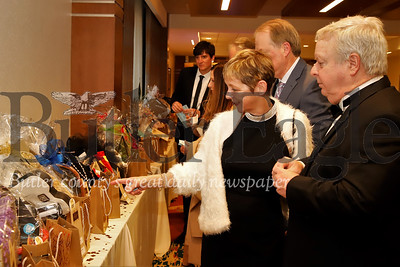Kate and Richard Beggy browse raffle and silent auction items at the 2020 Butler Health Systems Crystal Ball Saturday. Seb Foltz/Butler Eagle
