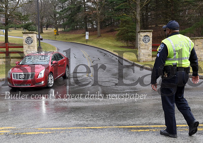 Harold Aughton/Butler Eagle: BC3 police officer Sgt. Michael Pearson directs traffic as students, faculty, and administrators evacuate campus Wednesday, March 11, 2020.