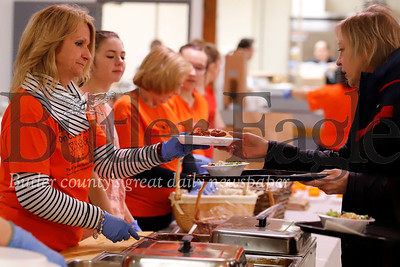Jeanne Bestwick (left) of North West Elementary, Butler Area High School senior Maggie Sarbey and other volunteers serve up meals at Wednesday evening's Spaghetti Dinner at the Tanglewood Senior Center. The dinner raises money for  the Golden Tornado Scholastic Foundation's Kids' Weekend Backpack Program. Seb Foltz/ Butler Eagle