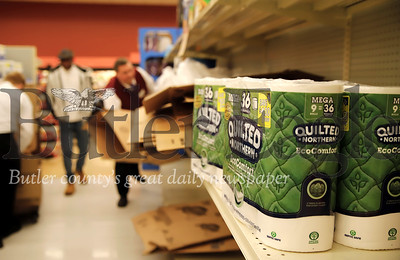 Toilet paper sits on the shelves at the Moraine Pointe Plaza Giant Eagle Thursday. While  the store was well stocked in most departments, customers Friday were taking certain items, such as toilet paper, off the shelves almost as fast as they were being restocked. One Giant Eagle official said there was a direct correlation between items being sold and items being recommended for puchase buy national and local news media. Seb Foltz/Butler Eagle