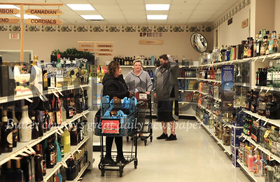 Customers stock  up on wine and liquor at the Fine Wine & Good Spirits in Seven Fields Tuesday. Seb Foltz/Butler Eagle