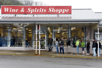 Harold Aughton/Butler Eagle: Customers lineup outside the Wine & Spirits Shoppe at the Greater Butler Mart plaza. Pennsylvania liquor stores will close indefinitely beginning at 9 pm today while the online store will close at 5 pm.