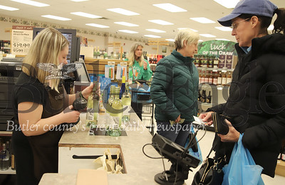 Amy Martin of Clay Township stocks up on wine at the Fine Wine & Good Spirits in Seven Fields Tuesday. Seb Foltz/Butler Eagle  (Cassie Hurd, working register)