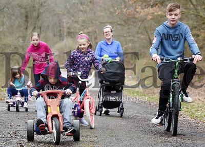 Harold Aughton/Butler Eagle: Melody Kiefer of Butler Twp. took her six children on a walk on the closed section of Alameda Road Thursday afternoon. Her children from left inlcude Aubrey,4, Rieley, 12, Emery,6, Lilly, 8,  Brody, 15 and 9-month old Pearce in the stroller.