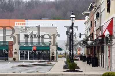 Harold Aughton/Butler Eagle: Commerce has come to a complete stop in Cranberry with empty parking lots and store fronts.