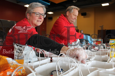 """""""Debbie Bond and Rick Pelloni are members of Victory Family Church's Dream Team, a group that provides for the church's needs through volunteer efforts. Bond and Pelloni were among church members who packaged and distributed food Wednesday."""" Photo by Samantha Beal."""