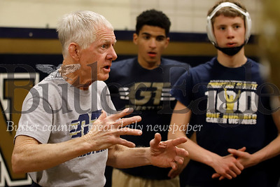 Butler assistant wrestling coach Fred Powell discusses technique during a team practice. Seb Foltz/Butler Eagle