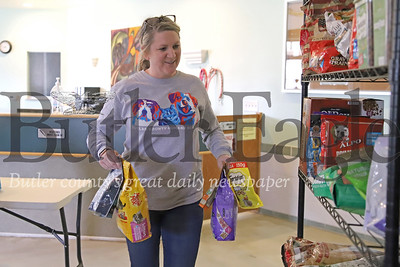 Butler County Humane Society executive director Jen DiCuccio stocks shelves with donated food Friday 03/28/20. The humane society is supplying free pet food to pet owners that may be financially impacted by the COVID-19 outbreak. Those in need are selected through a brief screening process that can be done over the phone. The shelter is open by appointment only during the shutdown. Staff is on-hand taking care of animals that remain onsite. Seb Foltz/Butler Eagle
