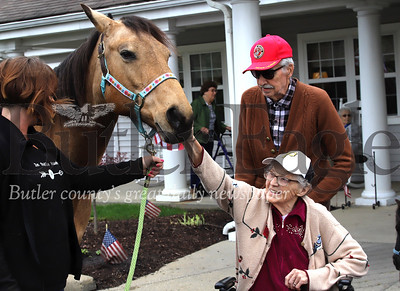 Lowerie Place Senior Living Community resident Edith Atkinson pets Gretchen; a horse from In Stable Hands equine therapy, with her husband Ray Atkinson. Residents of the Butler-area senior community had the chance to pet horses Wednesday as part of the community's effort to lift the spirits of its residents during COVID-19 lockdown. Residents came out one-at-a-time or with their significant other to interact with the animals Gretchen and a minature pony named Stormy. Seb Foltz/Butler Eagle
