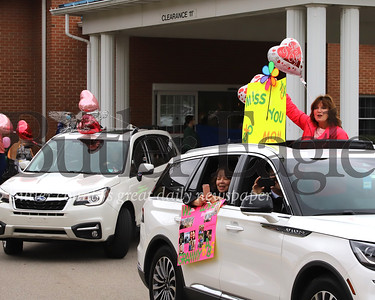 Members of the Hugo family and other visitors wave to residents of Concordia's Lund Care Center in Cabot Friday. The visit was the first time senior residents on lockdown were able to see some of their family members in person. Seb Foltz/Butler Eagle