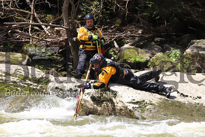A swiftwater search and rescue member prods a deep spot behind a rock in Slippery Rock Creek below McConnels Mill Sunday serching for the body of a missing 38-year-old hiker who fell into the creek Saturday afternoon. First responders and volunteers from four surrounding counties set up a large effort to canvas the stream looking for the mising hiker. Search began Saturday afternoon and was called off after dark. Searching resumed Sunday morning and were ongoing through the day. Seb Foltz/Butler Eagle