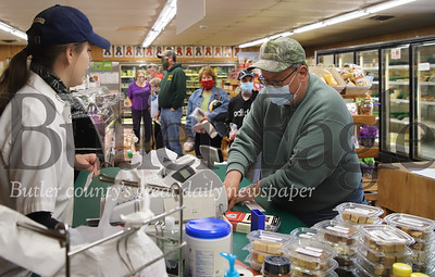 Kylie Thoma of Thoma Meat Market rings up Bill Benninger of Butler Friday 05/01/20. The market reopened Friday for the first time since the beginning of the COVID lockdown. Prior to Friday the market had been doing curbside pickup. Seb Foltz/Butler Eagle