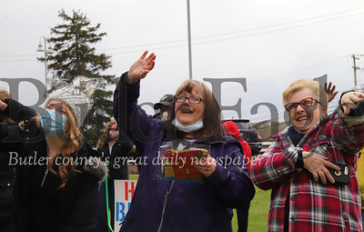 Caitlin Shaw (left), her mother Peggy Wilson and Bev McCanch wave to Wilson's mom and Shaw's grandmother Carol Kremer at Sunnyview Nursing and Rehabilitation center Saturday. Family gathered outside for Kremer's 82nd birthday. Kremer was able to chat via Facetime and wave from a second story window. Seb Foltz/Butler Eagle