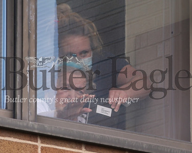 Carol Kremer waves to family from a second story window Sunnyview Nursing and Rehabilitation Center Saturday. Family gathered outside the facility and communicated via Facetime to celebrate her 82nd birthday.Seb Foltz/Butler Eagle
