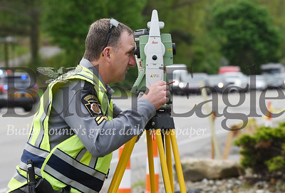 Harold Aughton/Butler Eagle: Corporal Brandt of the Pennsylvania State Police in Butler reconstructs the deadly accident that occurred early Sunday morning at the GOGO's along Rt. 8 in Middlesex Township on Tuesday, May 19, 2020.
