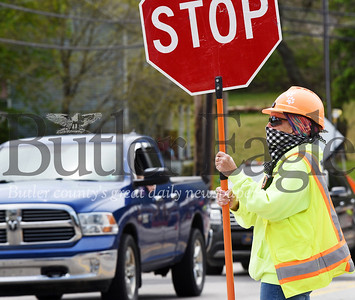 Harold Aughton/Butler Eagle: Bobbi Holzer of Gregori Construction in Sarver helps direct traffic through the Chicora bridge project Tuesday, May 19, 2020.