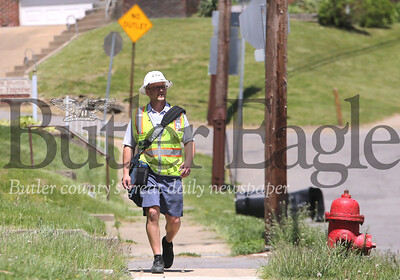 USPS mail carrier Ryan Weyandt walks his route on Mercer Road in Butler Thursday. Seb Foltz/Butler Eagle