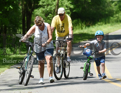 Harold Aughton/Butler Eagle: Gil Gilson of Portersville and his partner Linda Peifer of Butler took his great nephew Noah Cunningham,6, of Fredericksburg, VA on a bike ride at Moraine State Park Tuesday May 26, 2020.