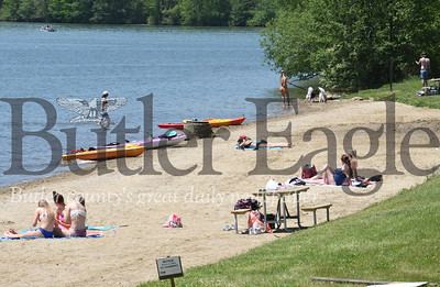Harold Aughton/Butler Eagle: Despite signs warning visitors to Moraine State Park that Lakeview Beach is closed, beach goers still took to the sand and water.