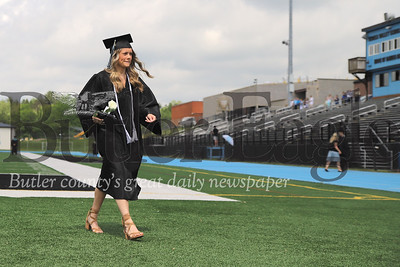 Senior Grace Sloan walks out of Seneca Valley's NexTier Stadium after graduating Friday. Students walked individually with family watching from the top of the stands. Families had to pickup and drop off their graduates to maintain safe practices for graduation. Seb Foltz/Butler Eagle