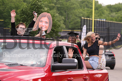 Skye Shoemaker and her family wave from their truck after picking the Seneca Valley senior up from her graduation walk. Seb Foltz/Butler Eagle