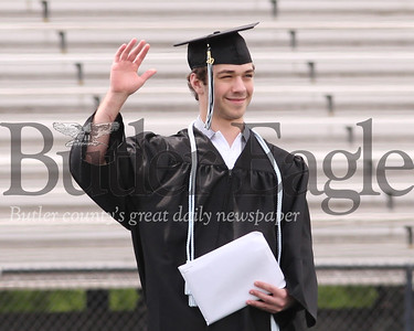 Blake Zahorchak waves to family after recieving his diploma Friday at Seneca Valley's Graduation ceremony. Seb Foltz/Butler Eagle