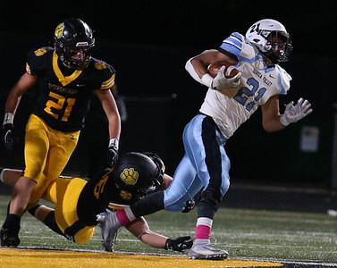 Seneca runningback Ethan West gets free from a tackle attempt for a short gain against North Allegheny in Friday night's 21-7 playoff loss at NA. Seb Foltz/Butler Eagle 10/30/20
