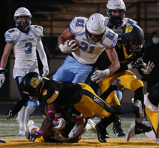 Seneca runningback Ethan West gets tackled after a short gain against North Allegheny in Friday night's 21-7 playoff loss at NA. Seb Foltz/Butler Eagle 10/30/20
