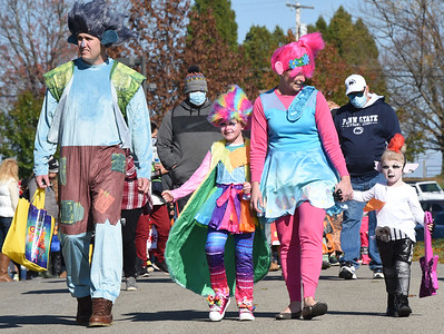 From left, Chris Edwards, daughter Lila, 8, his spouse Bethany and daughter Iris3, dressed for the Trolls World Tour while they attended the Adams Twp. Halloween parade Saturday, October 31, 2020. Harold Aughton/Butler Eagle