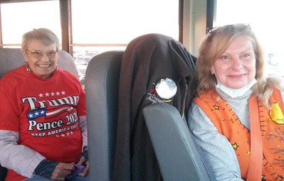 Alexis McEathron of Butler took a front seat in an ABC Transit bus driven by Peggy Bieber of Zelienople, right, at the temporary parking lot on Hicks Road for a ride to President Donald Trump's rally at the Pittsburgh-Butler Regional Airport.