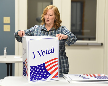 Renea Pomeroy, judge of elections for Mars Borough, sets up the voting stations at the Mars Library, Monday, November 2, 2020. Harold Aughton/Butler Eagle