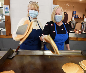 Sue Edwards, (left) and Cathy Glasgow of the Butler PM Rotary volunteered flipping pancakes for the 61st annual Election Day Pancake Festival sponsored by Lifesteps and the Butler Rotary club. Harold Aughton/Butler Eagle.
