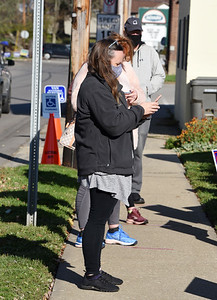 Keri Stephans of Mars stands in line to vote outside the Mars Library, Tuesday, November 3, 2020. Harold Aughton/Butler Eagle.