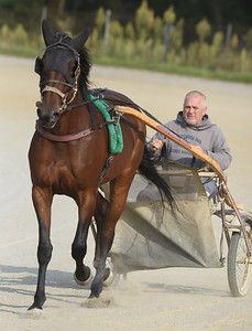 Gary Johnston takes a jog with one of his race horses around the Farm Show track. Harold Aughton/Butler Eagle.