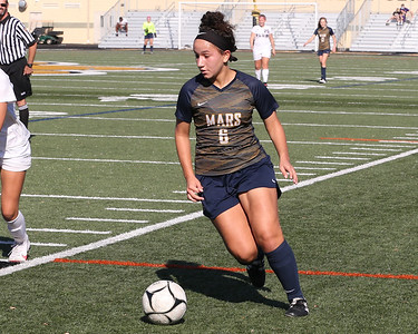 Mars' Londynn Gonzalez drives a ball downfield in Saturday's WPIAL championship at North Allegheny. Mars topped Plum 1-0 to earn back-to-back titles. Seb Foltz/Butler Eagle 11/7/20