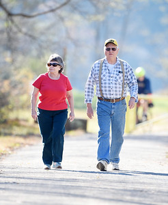 Retired nurse Peggy King of Chicora takes a walk along the Armstrong bike trail with her friend Jim Ciciarelli of Rimersburg Monday, Nov. 9, 2020. Harold Aughton/Butler Eagle