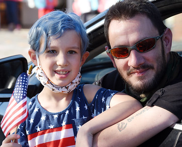 Airforce veteran Mathew Keasey of Butler and his daughter Amelia Keasey, 2nd grader, took part in the drive-through Veterans Day celebration at His Kids Christian School in Jefferson Twp. Tuesday, November 10, 2020.  Harold Aughton/Butler Eagle.