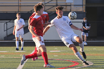 Seneca's Zack Lavalle traps a ball against Peters Township's Dominic Sambuco in Seneca's 4-3 come-from behind WPIAL Championship win in double overtime at North Allegheny. Seb Foltz/Butler Eagle 11/07/20