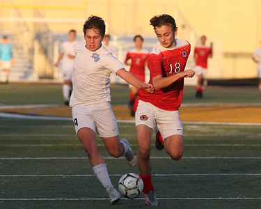 Seneca's Connor Schmidt tries to push hold off a challenge from Peters Township's Aidan Martik  in Seneca's 4-3 come-from behind WPIAL Championship win in double overtime at North Allegheny. Seb Foltz/Butler Eagle 11/07/20