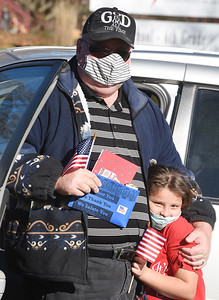 1111_LOC_HisKidsChristianSchool_6 Marine Corp. veteran Richard Mannas of Butler joined his granddaughter, 2nd grader, Maggie Koziar at the Hi Kids Christian School during the drive-through Veterans Day Celebration. About 90 students in pre-school through 6th grade cheered and sang patriotic songs.  Harold Aughton/Butler Eagle