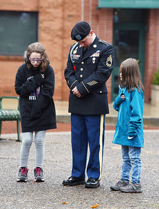 Amy Nation Guard reservist Matthew Sydlik of Butler attended the Veterans Day memorial service with his daughters Mekenzi, 12, and Madelynn, 7, Wednesday, November 11, 2020 held in Diamond Park. Harold Aughton/Butler Eagle