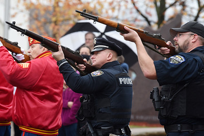 Officers of the Butler police department lent a hand during the Veterans Day memorial service in Diamond Park, Wednesday, November 11, 2020. Harold Aughton/Butler Eagle
