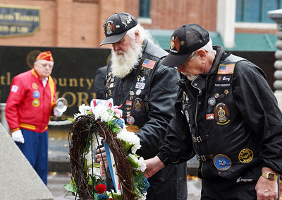 Army veteran Dennis Christie of Parker and Navy veteran LeRoy Bunyan of Renfrew (both members of the American Legion Riders) laid a wreath in Diamond Parkduring the Veterans Day memorial service, Wednesday, November 11, 2020. Harodl Aughton/Butler Eagle