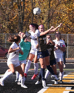 (EDITORS NOTE- DON'T RUN LARGE DUE TO RES) Mars' Caroline Wroblewski goes up for a header against Plum in Saturday's WPIAL championship at North Allegheny. Mars topped Plum 1-0 to earn back-to-back titles. Seb Foltz/Butler Eagle 11/7/20