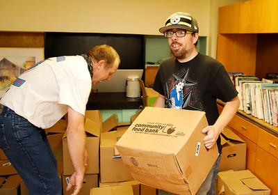 Chris Meegan of Butler carrys out a box of food for delivery as part of the  Butler Hip Hop and Rap Community's food drive for veterans Friday. Volunteers collected food at the Butler Art Center to be distributed to local veterans. Seb Foltz/Butler Eagle 11/13/20