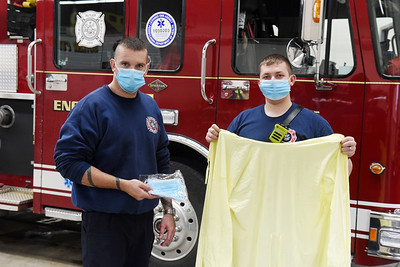 Butler firefighters Tim Iman, left, and James Stamm display the PP equipment the City of Butler received as part of a grant. Harold Aughton/Butler Eagle.