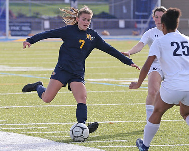 Mars' Gracie Dunaway looks to pass up field against Warren in Saturday's PIAA playoff at Mars. The Planets topped Warren 8-0. Seb Foltz/Butler Eagle 11/14/20