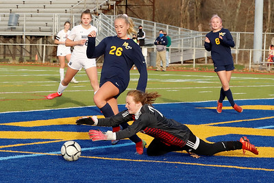 Mars's Ava Lewis tries to beat Warren goalie Alyssa Anderson to a ball in Saturday's PIAA playoff at Mars. Mars topped Warren 8-0. Seb Foltz/Butler Eagle 11/14/20